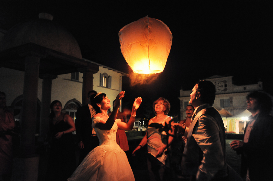 Bride and groom leave Chinese lantern in the sky